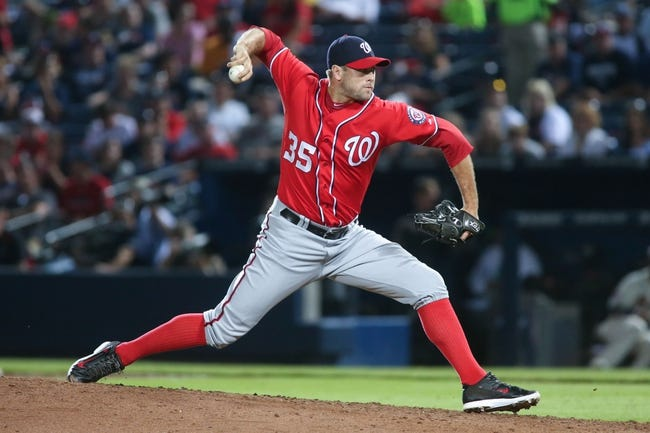 Aug 10, 2014; Atlanta, GA, USA; Washington Nationals relief pitcher Craig Stammen (35) delivers a pitch to an Atlanta Braves batter during their game at Turner Field. The Braves won 3-1. Mandatory Credit: Jason Getz-USA TODAY Sports