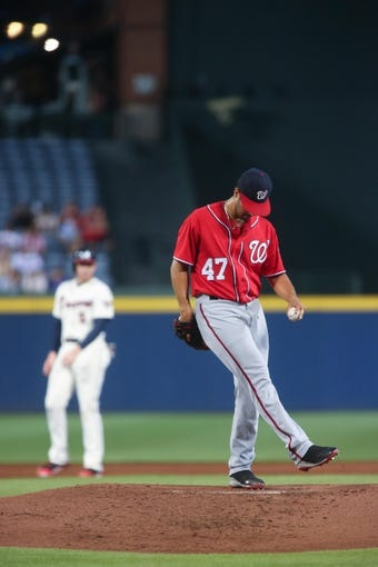 Aug 10, 2014; Atlanta, GA, USA; Washington Nationals starting pitcher Gio Gonzalez (47) reacts after giving up a hit in the first inning of their game against the Atlanta Braves at Turner Field. The Braves won 3-1. Mandatory Credit: Jason Getz-USA TODAY Sports