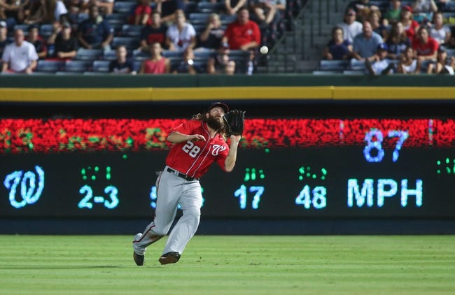 Aug 10, 2014; Atlanta, GA, USA; Washington Nationals right fielder Jayson Werth (28) catches an out from Atlanta Braves center fielder Emilio Bonifacio (1) during their game at Turner Field. The Braves won 3-1. Mandatory Credit: Jason Getz-USA TODAY Sports
