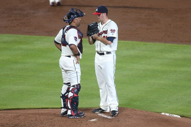 Aug 10, 2014; Atlanta, GA, USA; Atlanta Braves starting pitcher Alex Wood (40) talks with Atlanta Braves catcher Gerald Laird (11) during their game against the Washington Nationals at Turner Field. The Braves won 3-1. Mandatory Credit: Jason Getz-USA TODAY Sports
