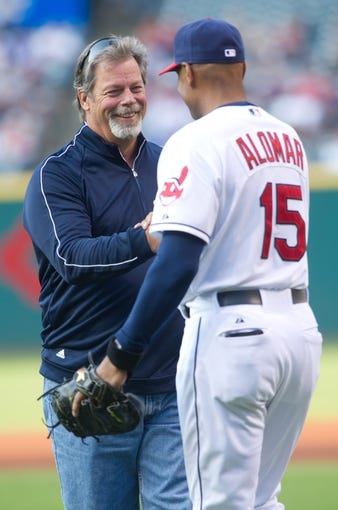 Aug 15, 2014; Cleveland, OH, USA; Cleveland Indians former pitcher Doug Jones meets with Cleveland Indians first base coach Sandy Alomar Jr. (15) after throwing out the ceremonial first pitch before the game between the Cleveland Indians and the Baltimore Orioles at Progressive Field. Mandatory Credit: Ken Blaze-USA TODAY Sports