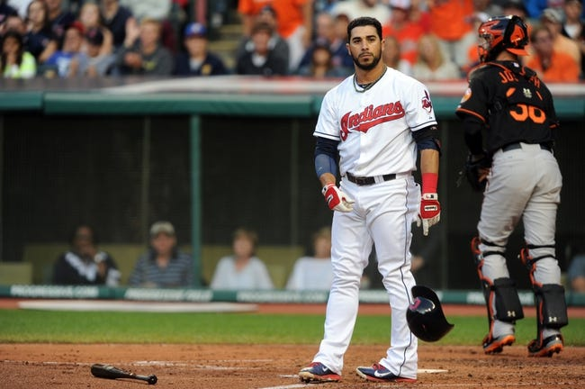 Aug 15, 2014; Cleveland, OH, USA; Cleveland Indians third baseman Mike Aviles (4) throws his helmet after striking out to end the third inning against the Baltimore Orioles at Progressive Field. Mandatory Credit: Ken Blaze-USA TODAY Sports