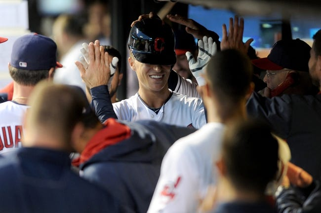 Aug 15, 2014; Cleveland, OH, USA; Cleveland Indians designated hitter Zach Walters (6) is congratulated after hitting a home run during the fifth inning against the Baltimore Orioles at Progressive Field. Mandatory Credit: Ken Blaze-USA TODAY Sports