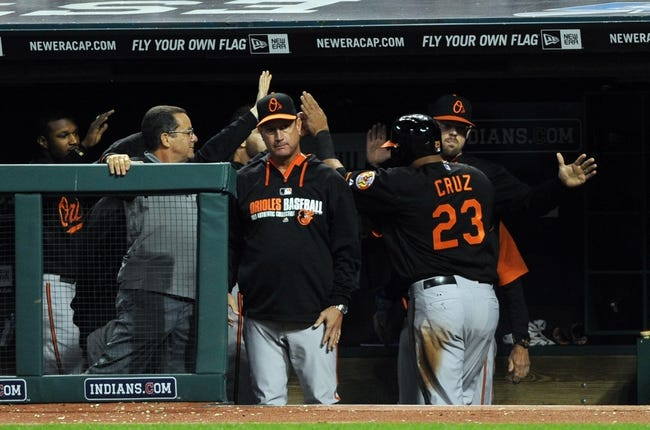 Aug 15, 2014; Cleveland, OH, USA; Baltimore Orioles left fielder Nelson Cruz (23) is congratulated after scoring during the eighth inning against the Cleveland Indians  at Progressive Field. Mandatory Credit: Ken Blaze-USA TODAY Sports