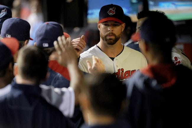 Aug 15, 2014; Cleveland, OH, USA; Cleveland Indians starting pitcher Corey Kluber (28) is congratulated in the dugout after leaving the game during the eighth inning against the Baltimore Orioles at Progressive Field. Mandatory Credit: Ken Blaze-USA TODAY Sports
