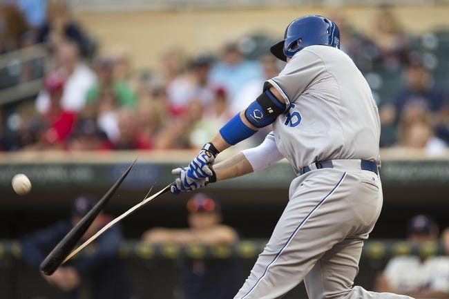 Aug 16, 2014; Minneapolis, MN, USA; Kansas City Royals first baseman Billy Butler (16) breaks his bat during an at bat in the second inning against the Minnesota Twins at Target Field. Mandatory Credit: Jesse Johnson-USA TODAY Sports