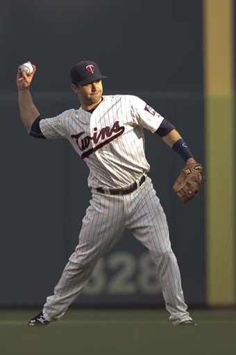Aug 16, 2014; Minneapolis, MN, USA; Minnesota Twins second baseman Brian Dozier (2) throws the ball to first base for an out in the second inning against the Kansas City Royals at Target Field. Mandatory Credit: Jesse Johnson-USA TODAY Sports