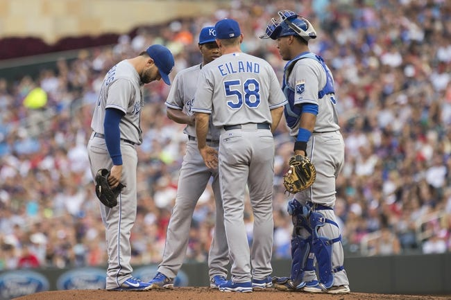 Aug 16, 2014; Minneapolis, MN, USA; Kansas City Royals pitching coach Dave Eiland (58) talks to starting pitcher Yordano Ventura (30), third baseman Mike Moustakas (8) and catcher Salvador Perez (13) during the second inning against the Minnesota Twins at Target Field. Mandatory Credit: Jesse Johnson-USA TODAY Sports
