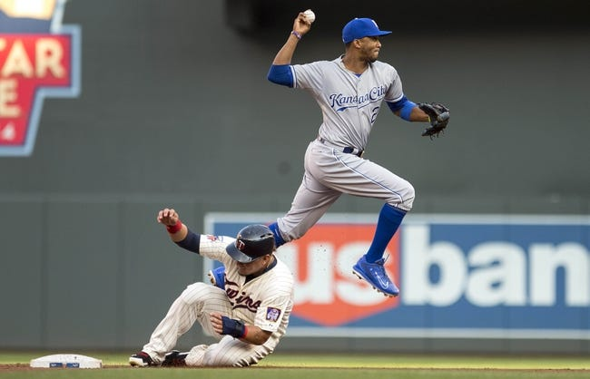Aug 16, 2014; Minneapolis, MN, USA; Kansas City Royals shortstop Alcides Escobar (2) jumps over Minnesota Twins right fielder Oswaldo Arcia (31) after making a force out at second and attempts to throw the ball to first base for a double play in the second inning at Target Field. Mandatory Credit: Jesse Johnson-USA TODAY Sports