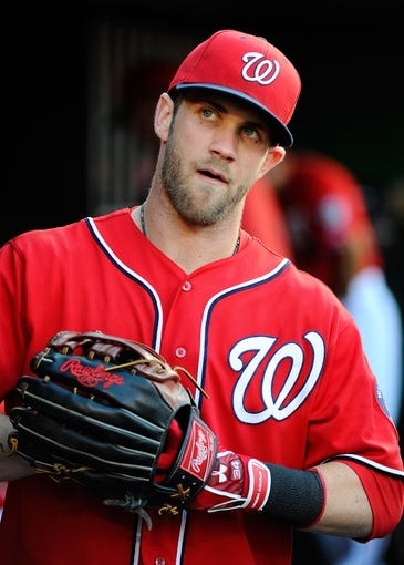 Aug 16, 2014; Washington, DC, USA; Washington Nationals left fielder Bryce Harper (34) in the dugout before the game against the Pittsburgh Pirates at Nationals Park. Mandatory Credit: Brad Mills-USA TODAY Sports