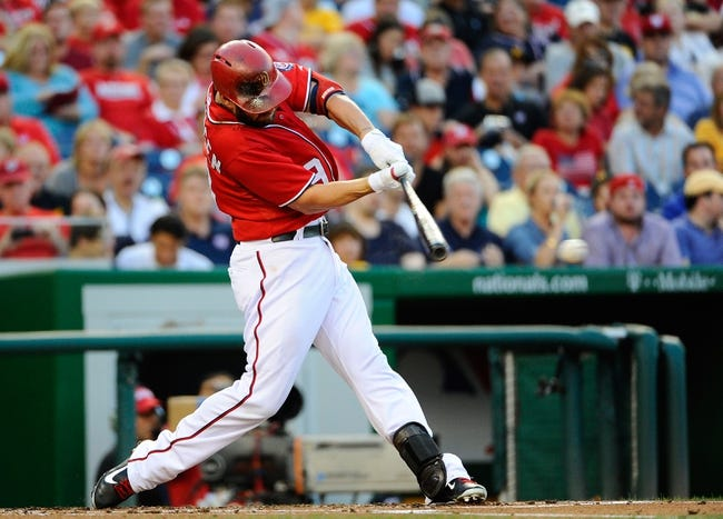 Aug 16, 2014; Washington, DC, USA; Washington Nationals left fielder Kevin Frandsen (19) hits a single during the first inning against the Pittsburgh Pirates at Nationals Park. Mandatory Credit: Brad Mills-USA TODAY Sports