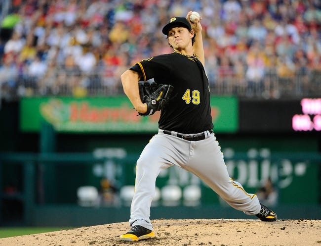 Aug 16, 2014; Washington, DC, USA; Pittsburgh Pirates starting pitcher Jeff Locke (49) throws during the second inning against the Washington Nationals at Nationals Park. Mandatory Credit: Brad Mills-USA TODAY Sports