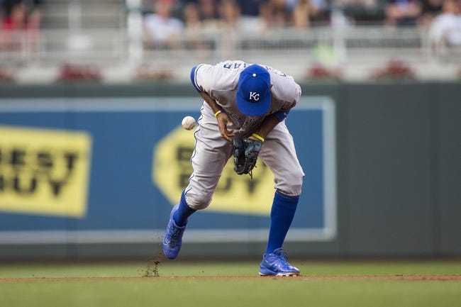 Aug 16, 2014; Minneapolis, MN, USA; Kansas City Royals infielder Alcides Escobar (2) bobbles a ground ball in the fourth inning against the Minnesota Twins at Target Field. Mandatory Credit: Jesse Johnson-USA TODAY Sports