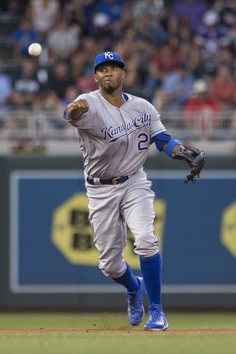 Aug 16, 2014; Minneapolis, MN, USA; Kansas City Royals shortstop Alcides Escobar (2) throws the ball to first base for an out in the sixth inning against the Minnesota Twins at Target Field. Mandatory Credit: Jesse Johnson-USA TODAY Sports