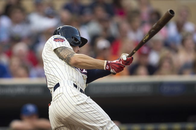 Aug 16, 2014; Minneapolis, MN, USA; Minnesota Twins center fielder Jordan Schafer (1) hits a single in the fifth inning against the Kansas City Royals at Target Field. Mandatory Credit: Jesse Johnson-USA TODAY Sports