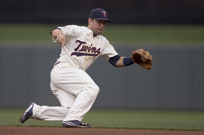 Aug 16, 2014; Minneapolis, MN, USA; Minnesota Twins second baseman Brian Dozier (2) fields a ground ball in the fifth inning against the Kansas City Royals at Target Field. Mandatory Credit: Jesse Johnson-USA TODAY Sports