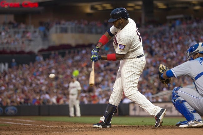 Aug 16, 2014; Minneapolis, MN, USA; Minnesota Twins designated hitter Kennys Vargas (19) hits a RBI sacrifice fly in the seventh inning against the Kansas City Royals at Target Field. Mandatory Credit: Jesse Johnson-USA TODAY Sports