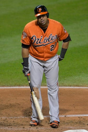 Aug 16, 2014; Cleveland, OH, USA; Baltimore Orioles designated hitter Nelson Cruz (23) reacts after striking out in the seventh inning against the Cleveland Indians at Progressive Field. Mandatory Credit: David Richard-USA TODAY Sports