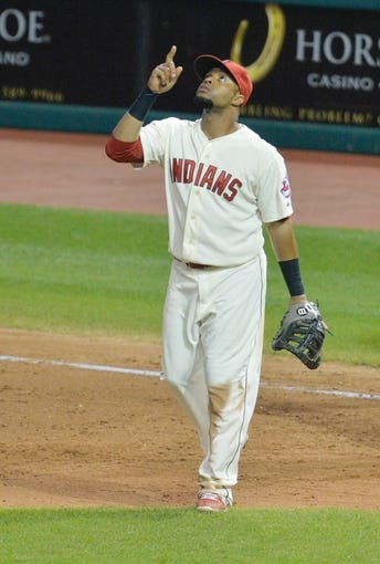Aug 16, 2014; Cleveland, OH, USA; Cleveland Indians first baseman Carlos Santana (41) celebrates after a 6-0 win over the Baltimore Orioles at Progressive Field. Mandatory Credit: David Richard-USA TODAY Sports