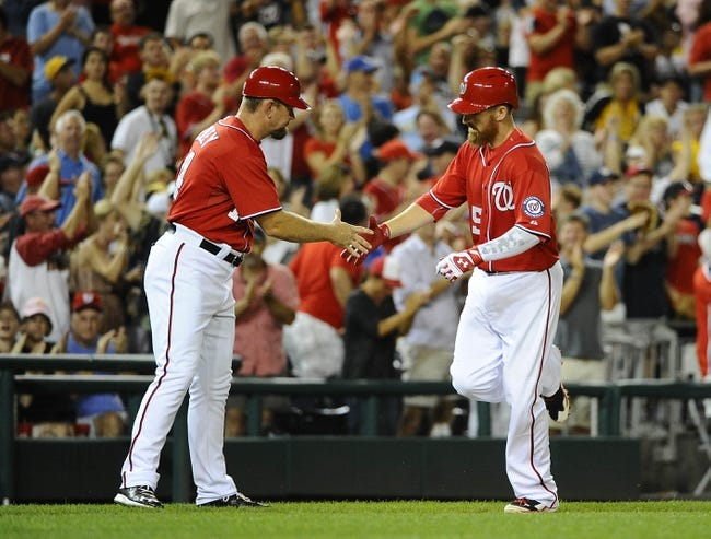 Aug 16, 2014; Washington, DC, USA; Washington Nationals first baseman Adam LaRoche (25) is congratulated by third base coach Bob Henley (14) after hitting a two run home run against the Pittsburgh Pirates during the eighth inning at Nationals Park. The Nationals won 4-3. Mandatory Credit: Brad Mills-USA TODAY Sports