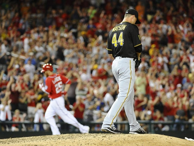 Aug 16, 2014; Washington, DC, USA; Pittsburgh Pirates relief pitcher Tony Watson (44) reacts after giving up a two run home run to Washington Nationals first baseman Adam LaRoche (25) during the eighth inning at Nationals Park. The Nationals won 4-3. Mandatory Credit: Brad Mills-USA TODAY Sports