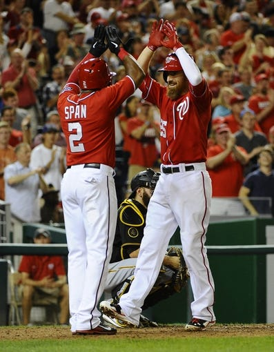 Aug 16, 2014; Washington, DC, USA; Washington Nationals first baseman Adam LaRoche (25) is congratulated by center fielder Denard Span (2) after hitting a two run home run against the Pittsburgh Pirates during the eighth inning at Nationals Park. The Nationals won 4-3. Mandatory Credit: Brad Mills-USA TODAY Sports