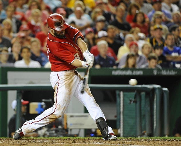 Aug 16, 2014; Washington, DC, USA; Washington Nationals left fielder Kevin Frandsen (19) hits an RBI single against the Pittsburgh Pirates during the eighth inning at Nationals Park. The Nationals won 4-3. Mandatory Credit: Brad Mills-USA TODAY Sports