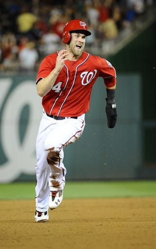 Aug 16, 2014; Washington, DC, USA; Washington Nationals left fielder Bryce Harper (34) runs to third base on his way to scoring the winning run against the Pittsburgh Pirates during the ninth inning at Nationals Park. The Nationals won 4-3. Mandatory Credit: Brad Mills-USA TODAY Sports