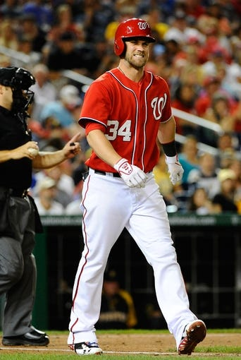Aug 16, 2014; Washington, DC, USA; Washington Nationals right fielder Bryce Harper (34) reacts after being hit by a pitch against the Pittsburgh Pirates during the seventh inning at Nationals Park. The Nationals won 4-3. Mandatory Credit: Brad Mills-USA TODAY Sports