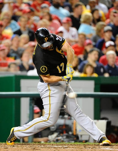 Aug 16, 2014; Washington, DC, USA; Pittsburgh Pirates first baseman Gaby Sanchez (17) hits a single against the Washington Nationals during the eighth inning at Nationals Park. The Nationals won 4-3. Mandatory Credit: Brad Mills-USA TODAY Sports