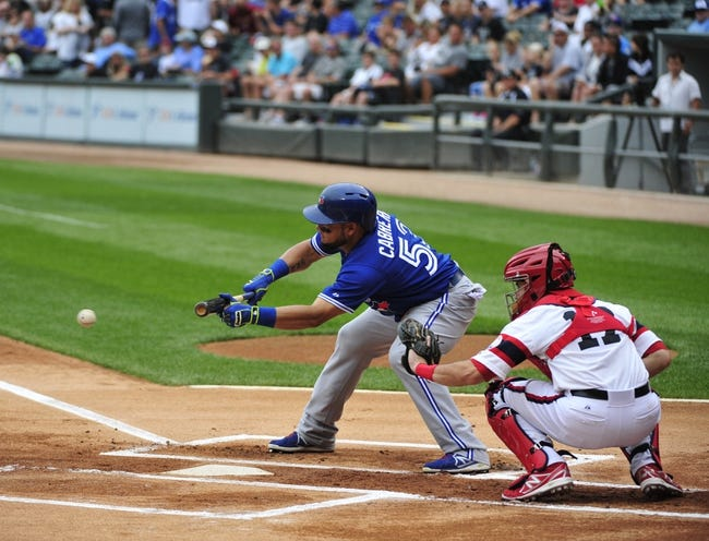 Aug 17, 2014; Chicago, IL, USA;  Toronto Blue Jays left fielder Melky Cabrera (53) lays down a sacrifice bunt against the Chicago White Sox during the first inning at U.S Cellular Field. Mandatory Credit: David Banks-USA TODAY Sports