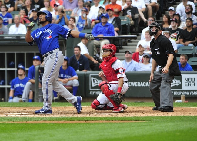Aug 17, 2014; Chicago, IL, USA; Toronto Blue Jays designated hitter Edwin Encarnacion (10) watches his two-run homer against the Chicago White Sox during the fifth inning at U.S Cellular Field. Mandatory Credit: David Banks-USA TODAY Sports