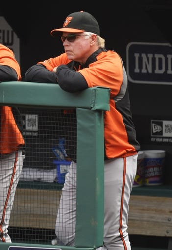 Aug 17, 2014; Cleveland, OH, USA; Baltimore Orioles manager Buck Showalter (26) watches from the dugout in the first inning against the Cleveland Indians at Progressive Field. Mandatory Credit: David Richard-USA TODAY Sports