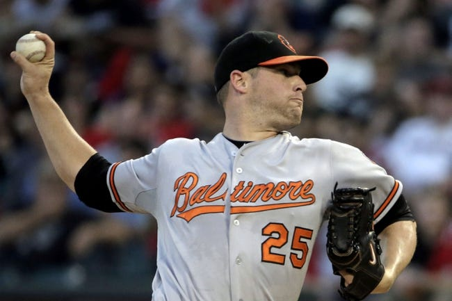 Aug 18, 2014; Chicago, IL, USA; Baltimore Orioles starting pitcher Bud Norris (25) pitches against the Chicago White Sox at U.S Cellular Field. Mandatory Credit: Jon Durr-USA TODAY Sports