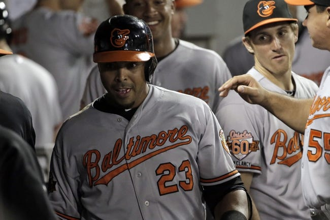 Aug 18, 2014; Chicago, IL, USA; Baltimore Orioles designated hitter Nelson Cruz (23) is congratulated by teammates after hitting a solo home run during the sixth inning at U.S Cellular Field. Mandatory Credit: Jon Durr-USA TODAY Sports