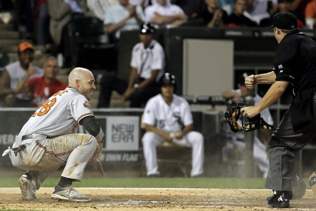 Aug 18, 2014; Chicago, IL, USA; Baltimore Orioles left fielder Steve Pearce (28) reacts after being tagged out at home plate by Chicago White Sox catcher Tyler Flowers (not pictured) during the fifth inning at U.S Cellular Field. Mandatory Credit: Jon Durr-USA TODAY Sports