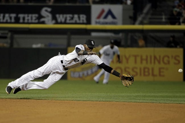 Aug 18, 2014; Chicago, IL, USA; Chicago White Sox shortstop Alexei Ramirez (10) fails to field a hit by Baltimore Orioles right fielder Nick Markakis (not pictured) during the fifth inning at U.S Cellular Field. Mandatory Credit: Jon Durr-USA TODAY Sports