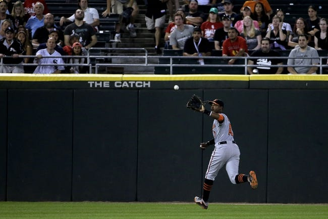Aug 18, 2014; Chicago, IL, USA; Baltimore Orioles center fielder Adam Jones (10) makes a catch to end the sixth inning that was hit by Chicago White Sox second baseman Gordon Beckham (not pictured) at U.S Cellular Field. Mandatory Credit: Jon Durr-USA TODAY Sports