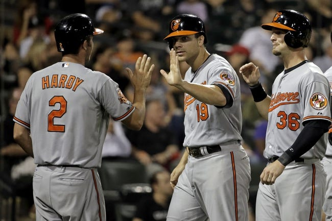 Aug 18, 2014; Chicago, IL, USA;Baltimore Orioles first baseman Chris Davis (19) and shortstop J.J. Hardy (2) and catcher Caleb Joseph (36) congratulate each other after scoring on a 3-run RBI double by second baseman Jonathan Schoop (not pictured) against the Chicago White Sox during the eighth inning at U.S Cellular Field. Mandatory Credit: Jon Durr-USA TODAY Sports