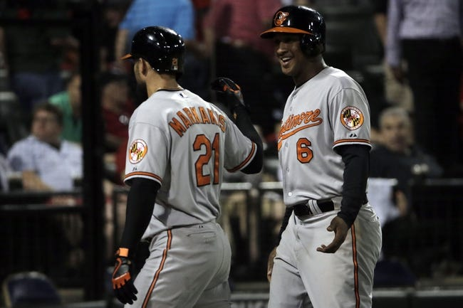 Aug 18, 2014; Chicago, IL, USA; Baltimore Orioles second baseman Jonathan Schoop (6) reacts after scoring on a 2-run home run by right fielder Nick Markakis (21) against the Chicago White Sox during the eighth inning at U.S Cellular Field. Mandatory Credit: Jon Durr-USA TODAY Sports