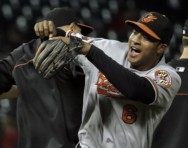 Aug 18, 2014; Chicago, IL, USA; Baltimore Orioles second baseman Jonathan Schoop (6) jumps up with a teammate after defeating the Chicago White Sox 8-2 at U.S Cellular Field. Mandatory Credit: Jon Durr-USA TODAY Sports