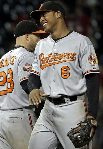 Aug 18, 2014; Chicago, IL, USA; Baltimore Orioles second baseman Jonathan Schoop (6) reacts after defeating the Chicago White Sox 8-2 at U.S Cellular Field. Mandatory Credit: Jon Durr-USA TODAY Sports