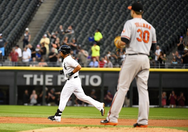 Aug 19, 2014; Chicago, IL, USA; Chicago White Sox first baseman Jose Abreu (79) runs the bases after hitting a home run against Baltimore Orioles starting pitcher Chris Tillman (30) during the first inning at U.S Cellular Field. Mandatory Credit: Mike DiNovo-USA TODAY Sports