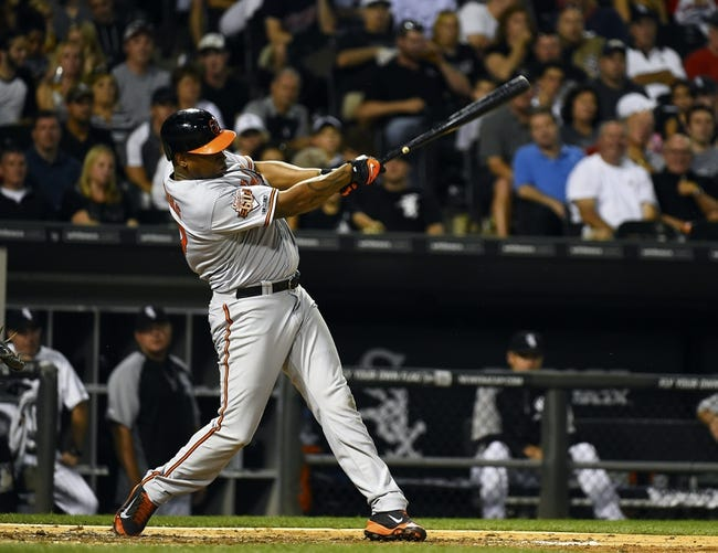 Aug 19, 2014; Chicago, IL, USA; Baltimore Orioles designated hitter Delmon Young (27) hits a RBI single against the Chicago White Sox during the sixth inning at U.S Cellular Field. Mandatory Credit: Mike DiNovo-USA TODAY Sports