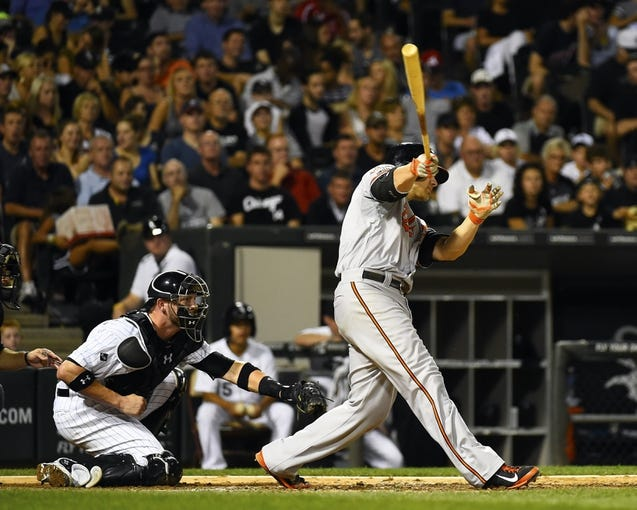 Aug 19, 2014; Chicago, IL, USA; Baltimore Orioles first baseman Chris Davis (19) hits a two run double against the Chicago White Sox during the sixth inning at U.S Cellular Field. Mandatory Credit: Mike DiNovo-USA TODAY Sports