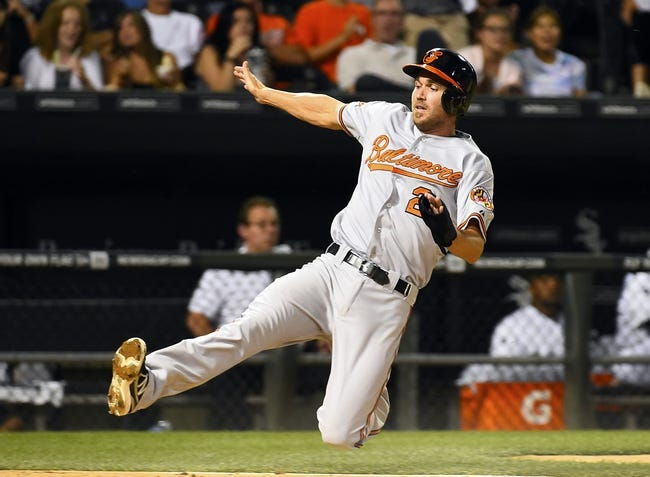 Aug 19, 2014; Chicago, IL, USA; Baltimore Orioles shortstop J.J. Hardy (2) slides into home plate against the Chicago White Sox during the sixth inning at U.S Cellular Field. Mandatory Credit: Mike DiNovo-USA TODAY Sports