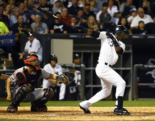 Aug 19, 2014; Chicago, IL, USA; Chicago White Sox left fielder Alejandro De Aza (30) hits a single against the Baltimore Orioles during the third inning at U.S Cellular Field. Mandatory Credit: Mike DiNovo-USA TODAY Sports
