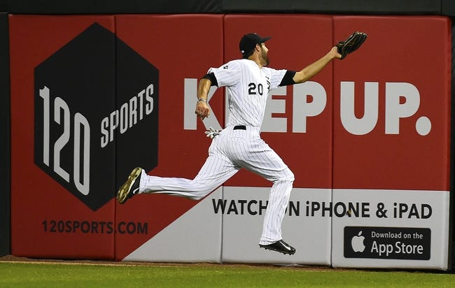 Aug 19, 2014; Chicago, IL, USA; Chicago White Sox center fielder Jordan Danks (20) makes a leaping catch against the Baltimore Orioles during the fourth inning at U.S Cellular Field. Mandatory Credit: Mike DiNovo-USA TODAY Sports