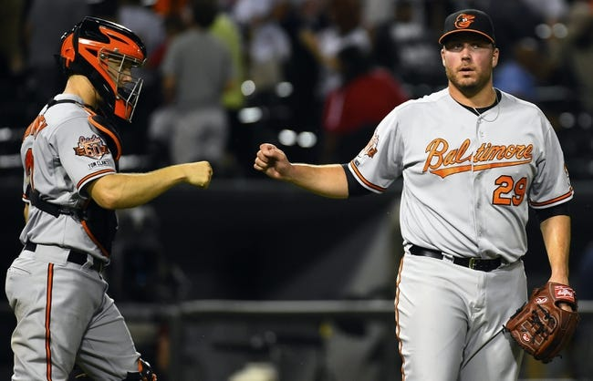 Aug 19, 2014; Chicago, IL, USA; Baltimore Orioles relief pitcher Tommy Hunter (29) reacts with Nick Hundley (40) after the ninth inning at U.S Cellular Field. Baltimore Orioles defeat the Chicago White Sox 5-1. Mandatory Credit: Mike DiNovo-USA TODAY Sports