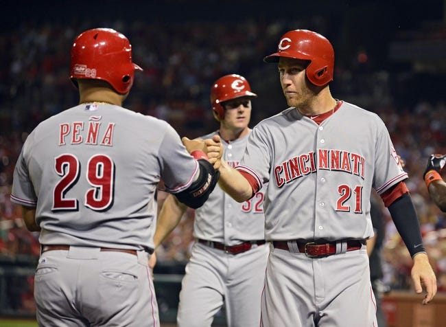 Aug 19, 2014; St. Louis, MO, USA; Cincinnati Reds third baseman Todd Frazier (21) celebrates with Brayan Pena (29) after scoring during the sixth inning against the St. Louis Cardinals at Busch Stadium. Mandatory Credit: Jeff Curry-USA TODAY Sports